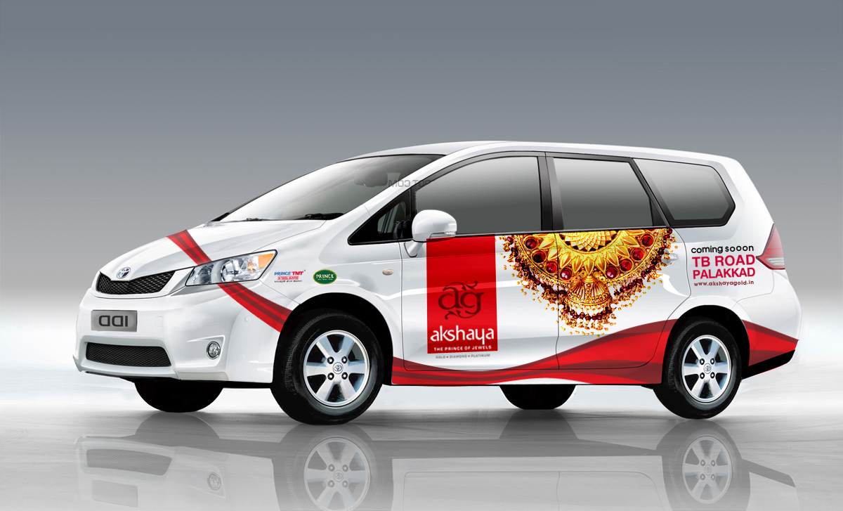 A Toyota Innova vehicle with Akshaya Gold & Diamonds Coming soon campain design